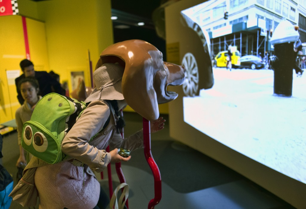 In this Tuesday, March 12, 2019 photo, a visitor takes part in an immersive experience showing visitors how dogs see from inside the head of a dog at