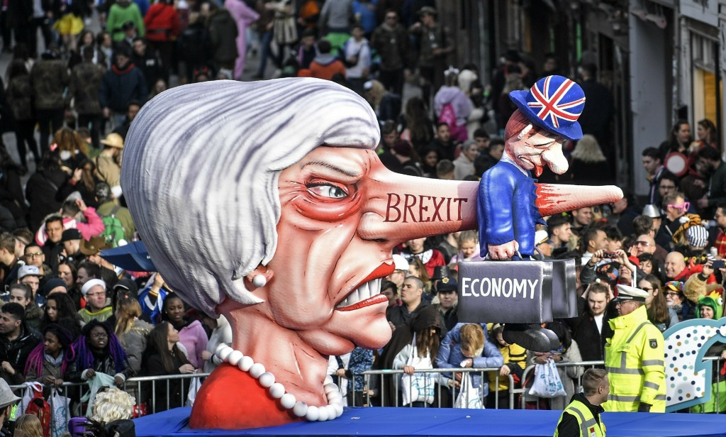 FILE - In this Monday, March 4, 2019 file photo a carnival float depicts British Prime Minister Theresa May and the Brexit during the traditional carn
