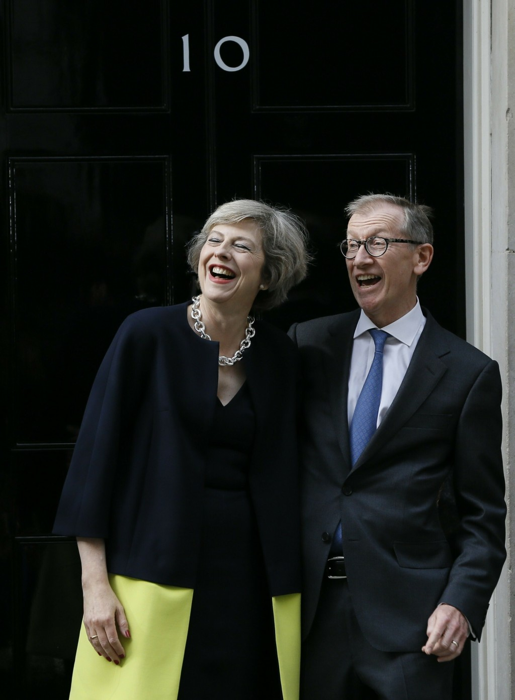 FILE - In this Wednesday, July 13, 2016 file photo, new British Prime Minister Theresa May and her husband Philip May stand on the steps of 10 Downing