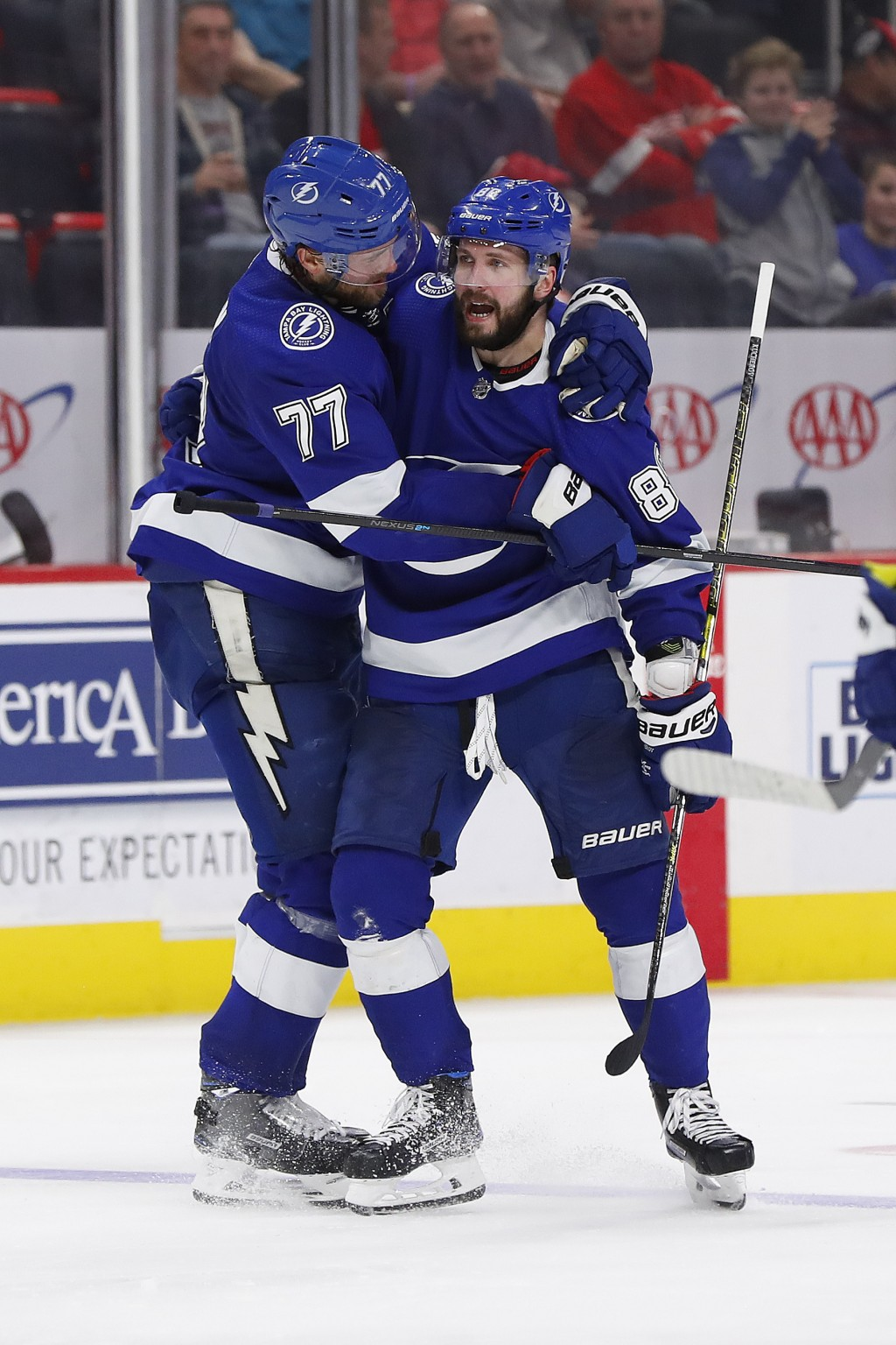 Tampa Bay Lightning right wing Nikita Kucherov (86) celebrates his goal with Victor Hedman (77) in the third period of an NHL hockey game against the