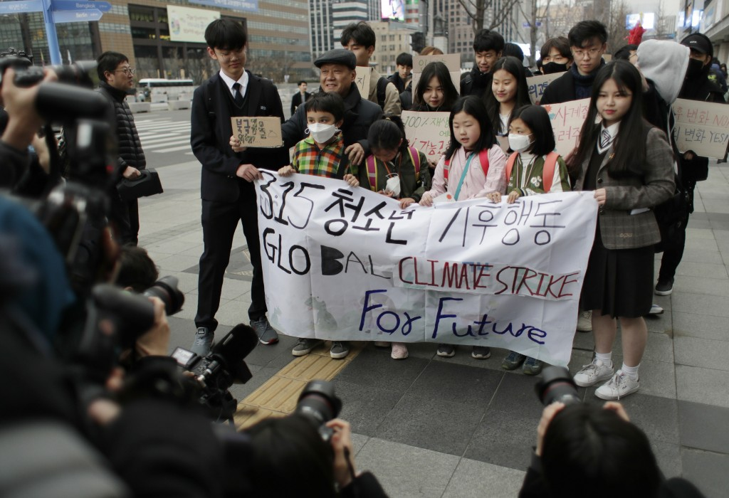Participants march during a rally for global climate strike for future in Seoul, South Korea, Friday, March 15, 2019. About 150 students and other pro...
