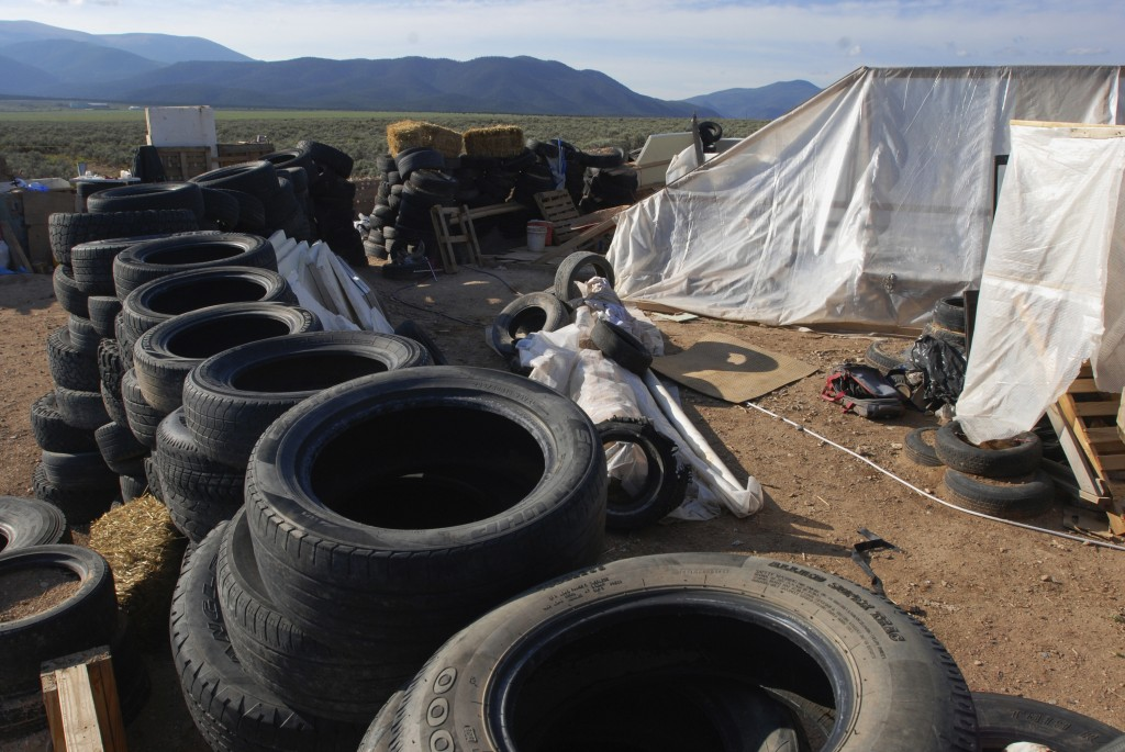 FILE - In this Aug. 10, 2018, file photo, is a makeshift living compound in Amalia, N.M. The five men and women found living in a ramshackle compound