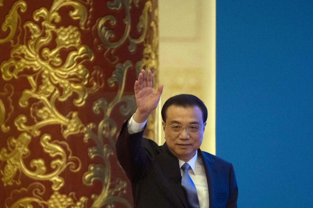 Chinese Premier Li Keqiang arrives for a press conference after the closing session of the National People's Congress in Beijing's Great Hall of the P