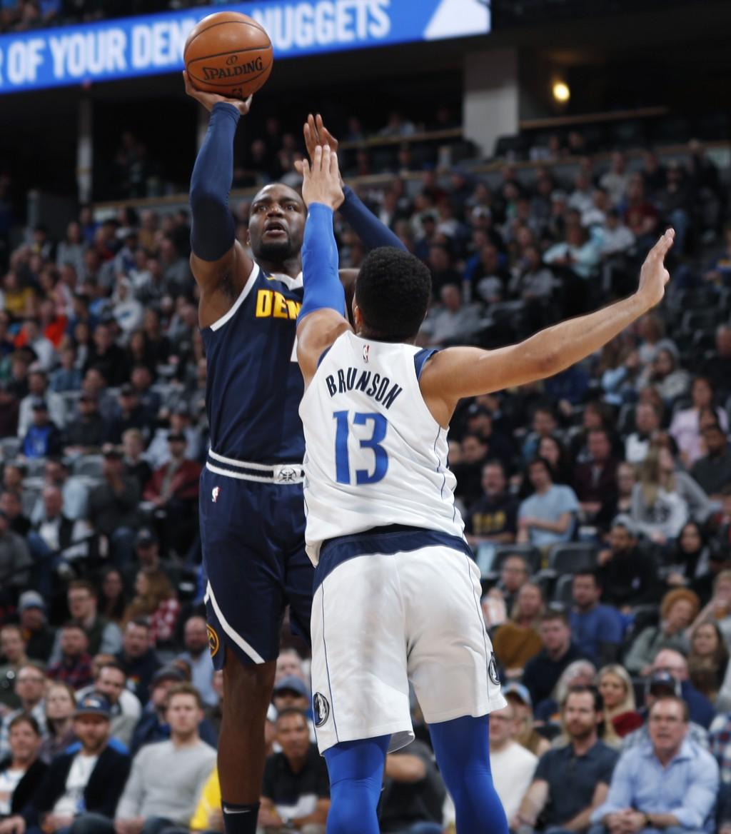 Denver Nuggets forward Paul Millsap shoots over Dallas Mavericks guard Jalen Brunson during the first half of an NBA basketball game Thursday, March 1