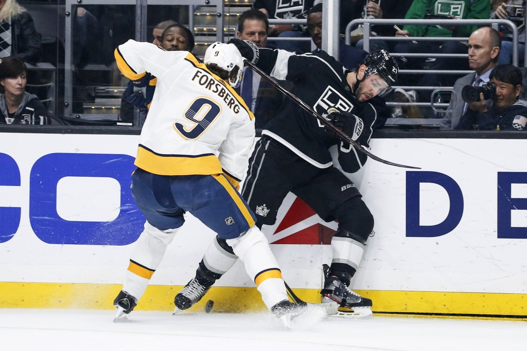 Nashville Predators forward Filip Forsberg (9) and Los Angeles Kings defenseman Alec Martinez (27) vie for the puck during the first period of an NHL