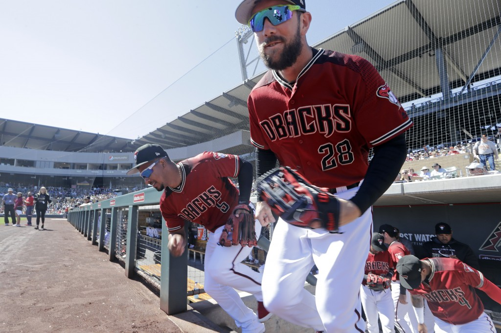 Arizona Diamondbacks' Steven Souza Jr. (28) and Eduardo Escobar (5) lead players out of the dugout before a spring training baseball game against the