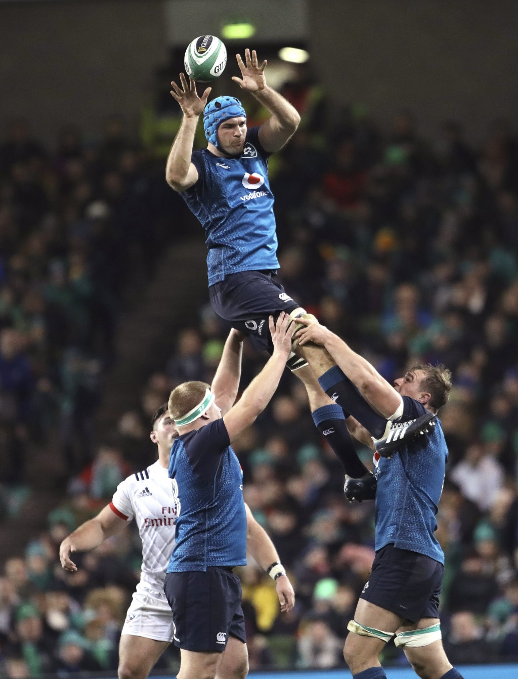 FILE - In this file photo dated Saturday, Nov 24, 2018, Ireland's Tadhg Beirne, top, wins a line out against the USA during their Rugby Union Internat