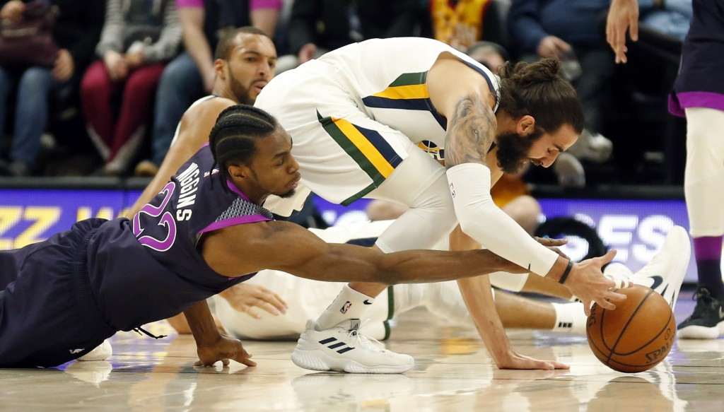 Minnesota Timberwolves forward Andrew Wiggins (22) battles with Utah Jazz guard Ricky Rubio, right, for the ball in the first half during an NBA baske
