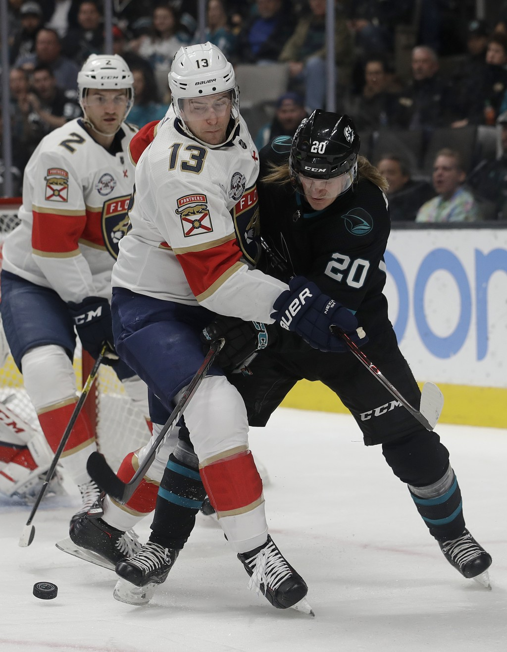 San Jose Sharks left wing Marcus Sorensen (20) reaches for the puck against Florida Panthers defenseman Mark Pysyk (13) during the first period of an
