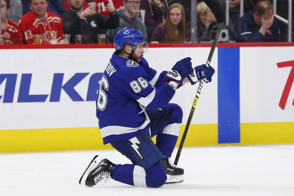 Tampa Bay Lightning right wing Nikita Kucherov (86) celebrates his goal against the Detroit Red Wings in the third period of an NHL hockey game, Thurs