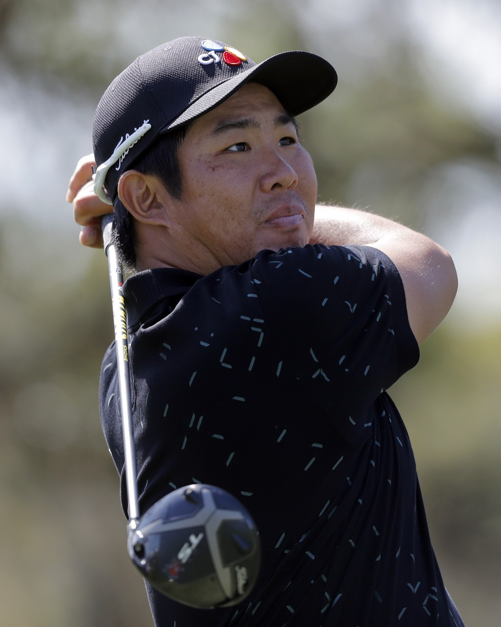 Byeong-Hun An, of South Korea, tees off on the ninth hole during the first round of The Players Championship golf tournament Thursday, March 14, 2019,