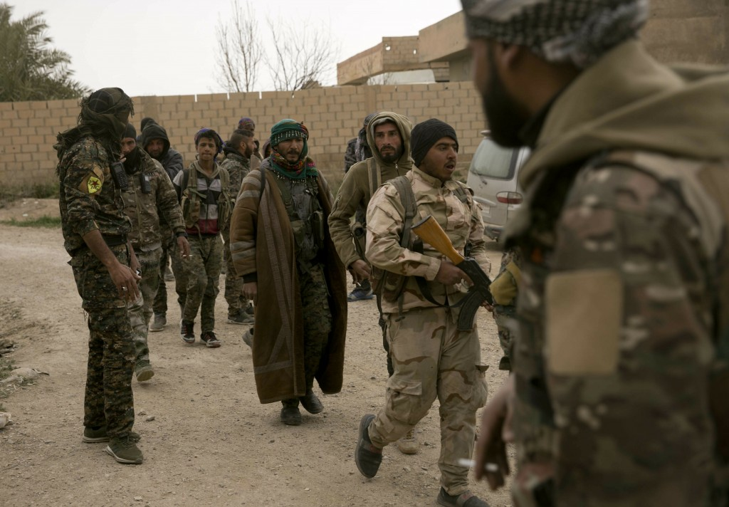 U.S.-backed Syrian Democratic Forces (SDF) gather outside Baghouz, Syria, to go to the front line where Islamic State militants are staging counter at