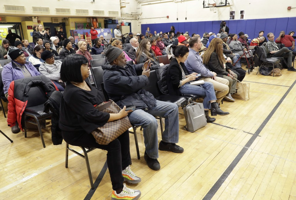 FILE- In this Thursday, March 7, 2019 photo, residents of the Queensbridge Houses listen during a community town hall called by HUD executive Lynne Pa