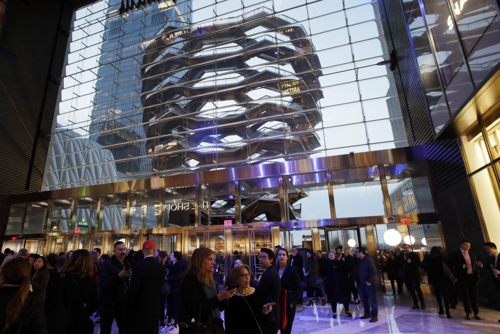 People attend the opening of the Neiman Marcus department store during the opening night of The Shops & Restaurants at Hudson Yards, Thursday, March 1