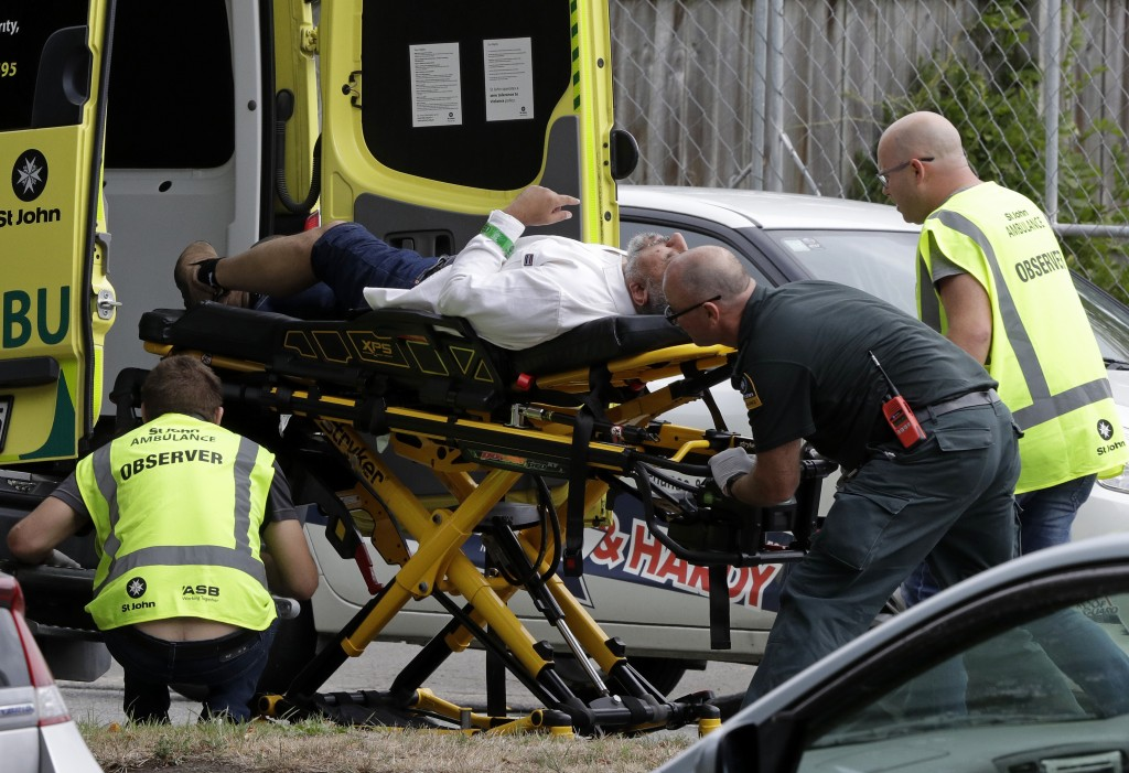 Ambulance staff take a man from outside a mosque in central Christchurch, New Zealand, Friday, March 15, 2019.  Multiple people were killed in mass sh