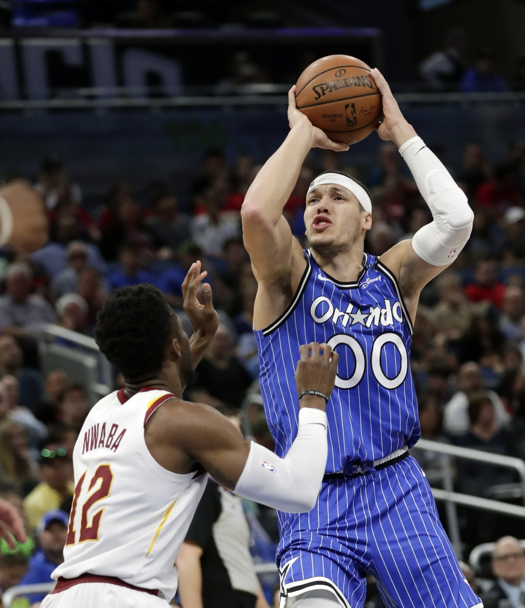 Orlando Magic's Aaron Gordon (00) shoots over Cleveland Cavaliers' David Nwaba (12) during the first half of an NBA basketball game, Thursday, March 1
