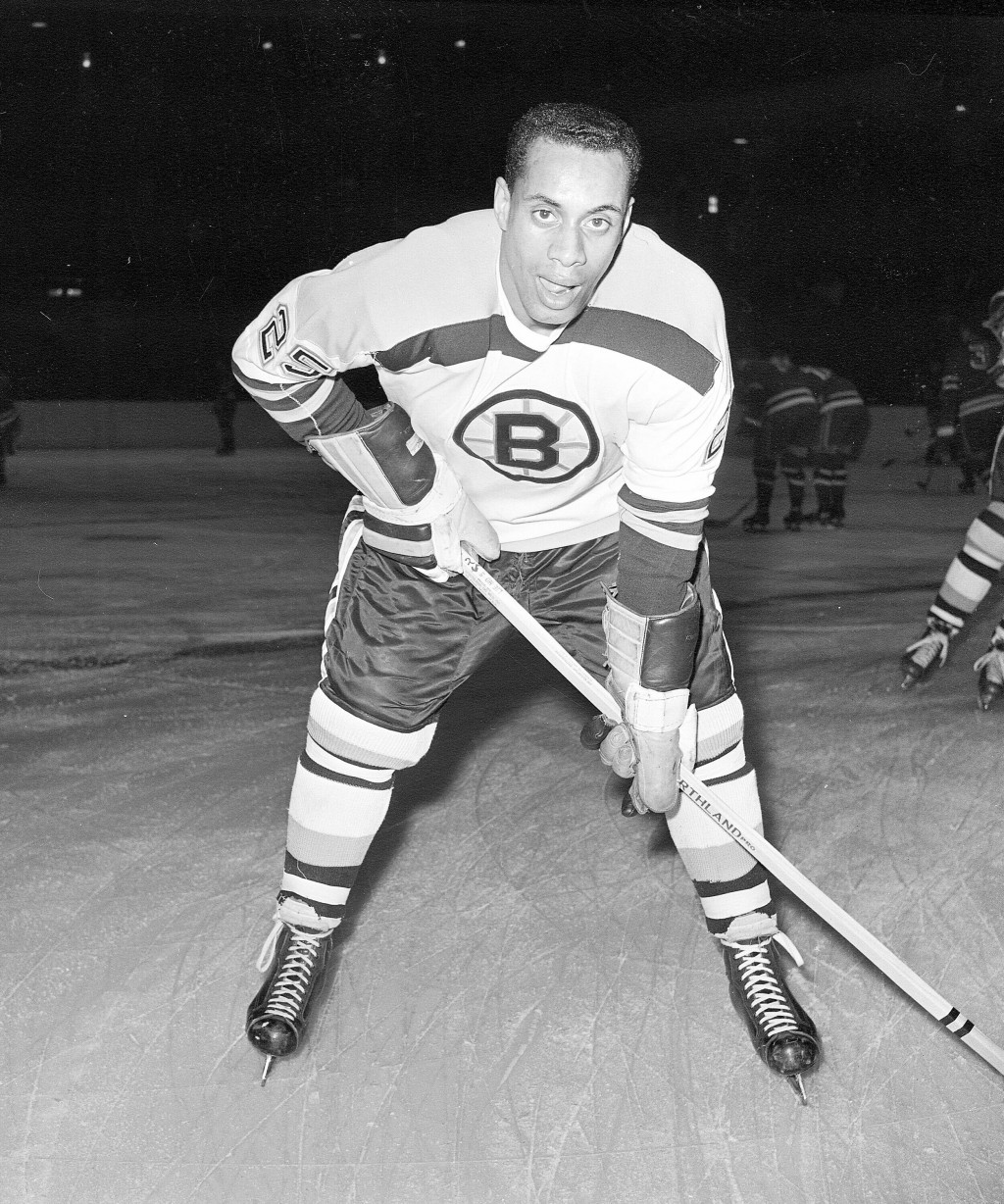 FILE - In this November 23, 1960 file photo, 25-year-old left wing Willie O'Ree, the first black player of the National Hockey League, warms up in his