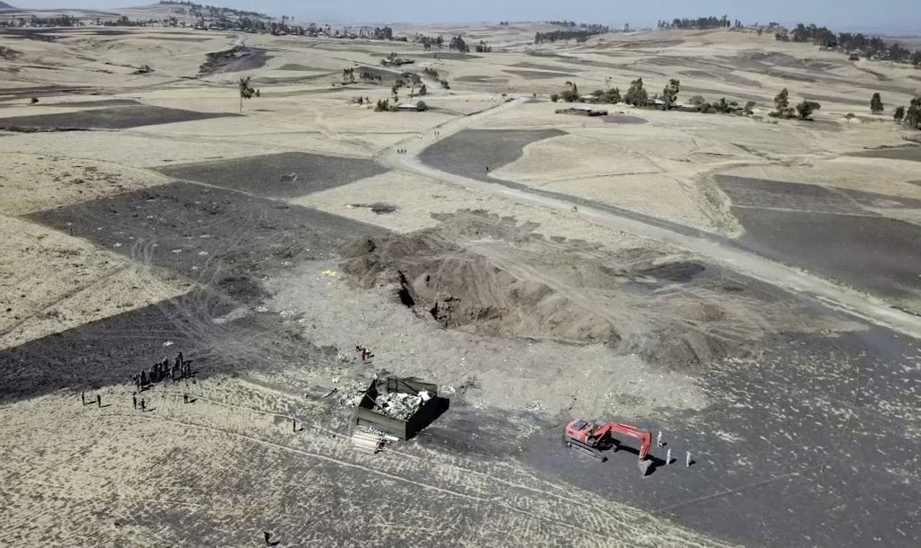 This aerial image made from video shows recovery work continuing at the scene where the Ethiopian Airlines Boeing 737 Max 8 crashed shortly after take