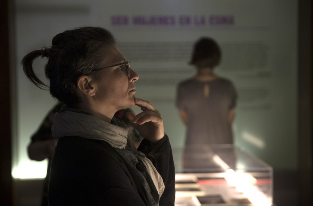 People attend the inauguration of an exhibit that recounts harrowing stories of dictatorship-era gender-based violence, at the former Naval Mechanics