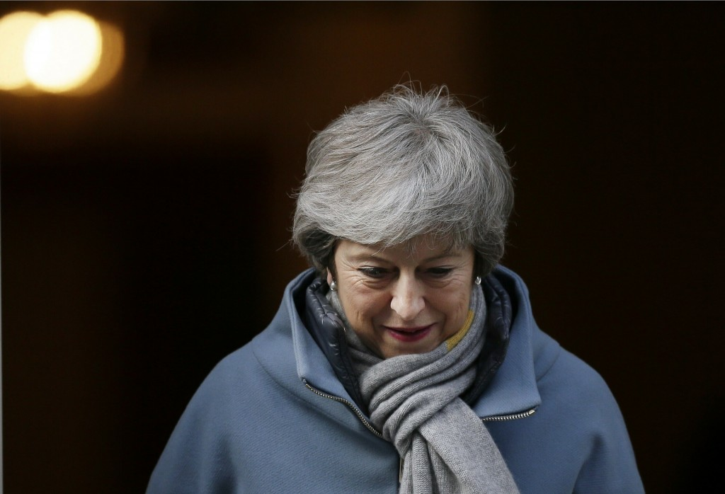 Britain's Prime Minister Theresa May leaves 10 Downing street in London, Thursday, March 14, 2019. British lawmakers faced another tumultuous day Thur