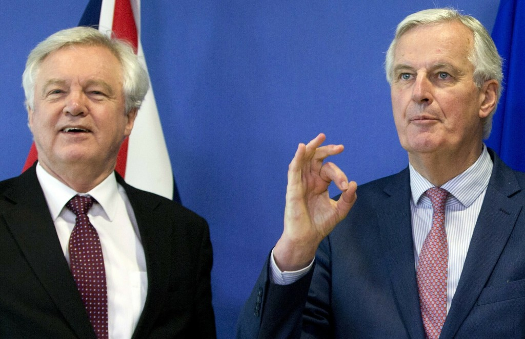 FILE - In this Monday, March 19, 2018 file photo European Union chief Brexit negotiator Michel Barnier, right, gestures as he meets with British Secre