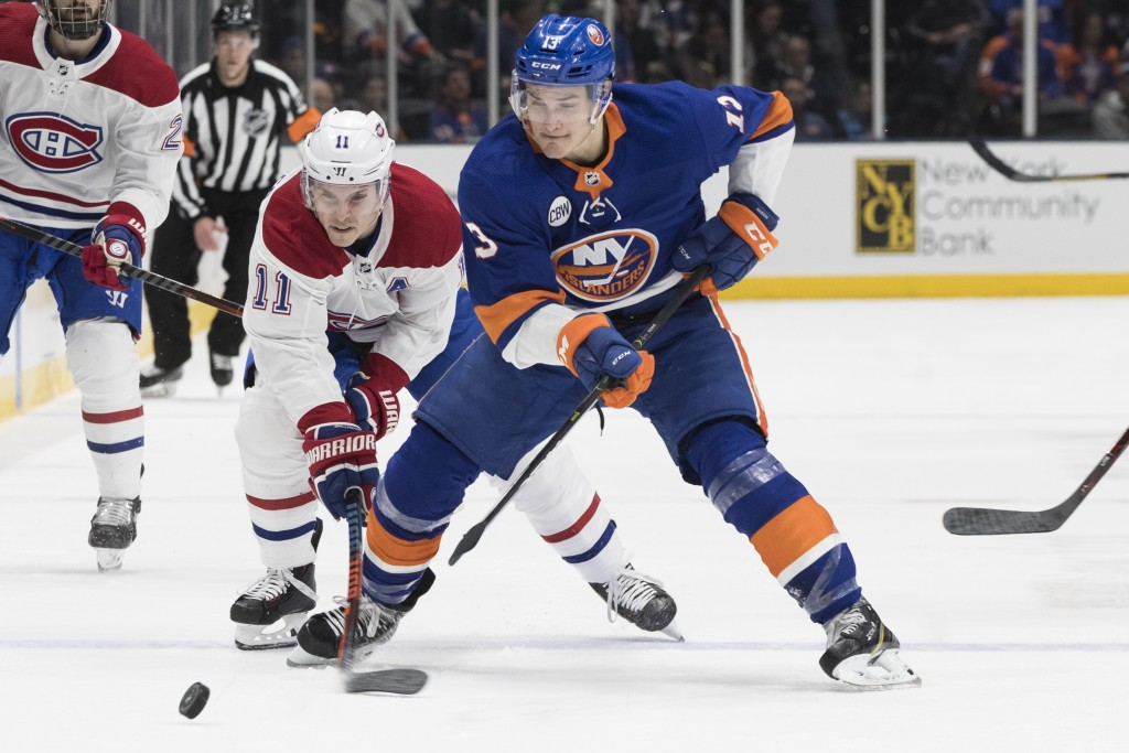 New York Islanders center Mathew Barzal (13) skates against Montreal Canadiens right wing Brendan Gallagher during the first period of an NHL hockey g