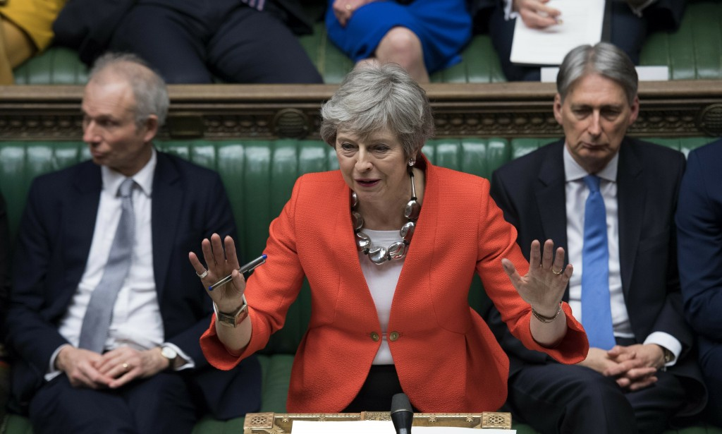 FILE - In this Tuesday March 12, 2019 file photo Britain's Prime Minister Theresa May speaks to lawmakers in parliament, London. Britain's love-hate r