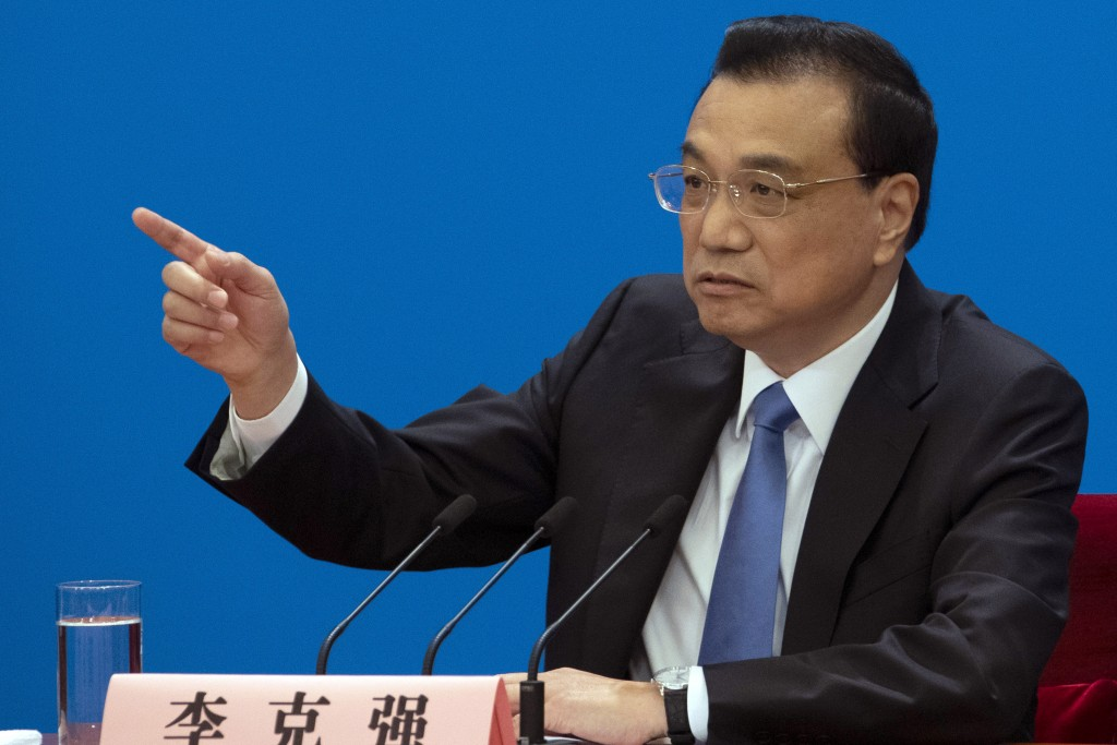 Chinese Premier Li Keqiang speaks during a press conference after the closing session of the National People's Congress in Beijing's Great Hall of the