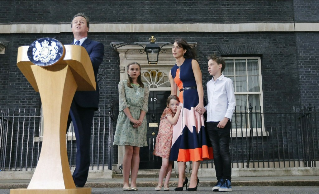 FILE - In this Wednesday, July 13, 2016 file photo Britain's Prime Minister David Cameron, speaks to the media as his wife Samantha and their children