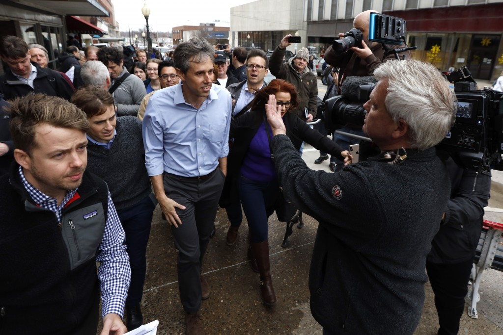 In this March 14, 2019, photo, former Texas congressman Beto O'Rourke speaks to reporters after a meet and greet at the Beancounter Coffeehouse & Drin