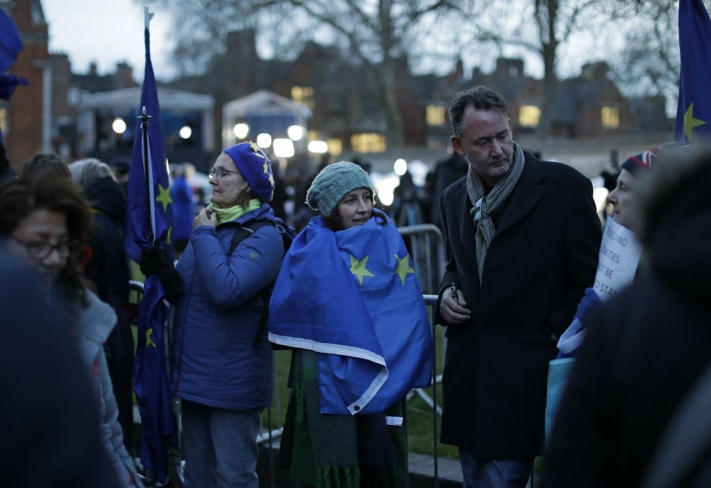 Anti-Brexit, pro-remain in the European Union supporters gather outside the Houses of Parliament in London, Thursday, March 14, 2019. British lawmaker