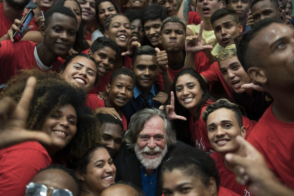 "Brazilian actor Jose de Abreu poses for a photo with fans after arriving at the international airport for his ""inauguration ceremony"" in Rio de Janeir"