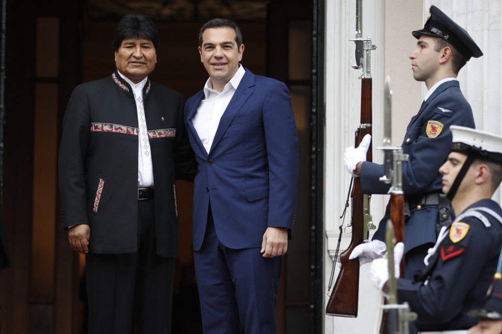 Greece's Prime Minister Alexis Tsipras, right, welcomes Bolivia's President Evo Morales at Maximos Mansion in Athens, Friday, March 15, 2019. Bolivia'