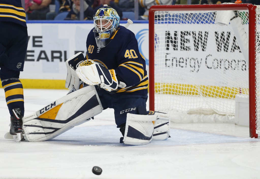 Buffalo Sabres forward Carter Hutton (40) makes a save during the second period of the team's NHL hockey game against the Pittsburgh Penguins, Thursda
