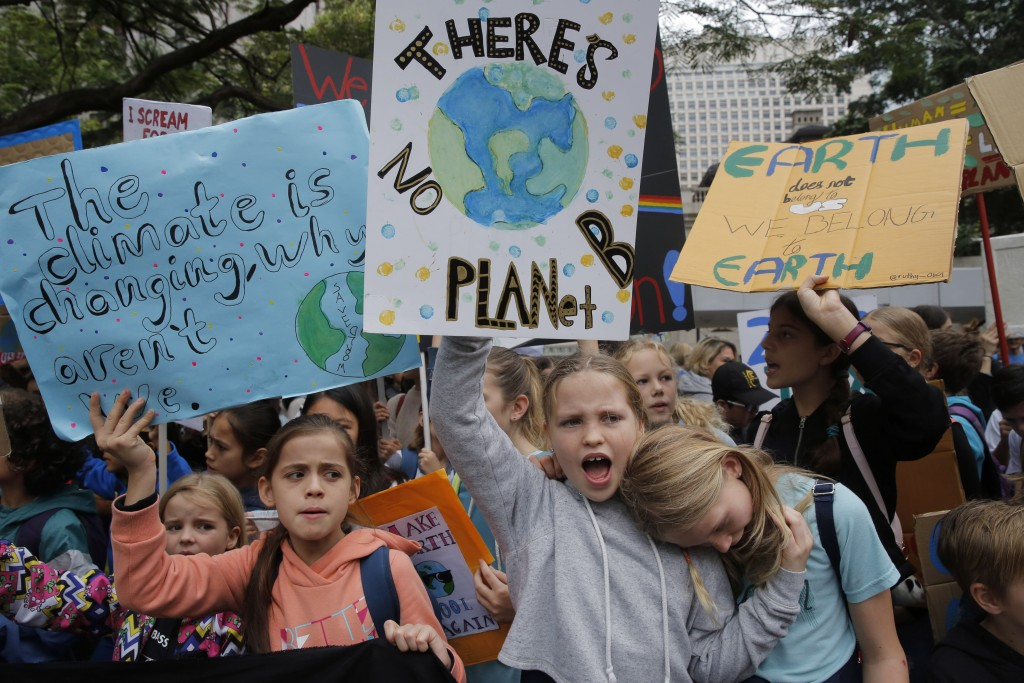 Hundreds of schoolchildren take part in a climate protest in Hong Kong, Friday, March 15, 2019. Students in more than 80 countries and territories wor...