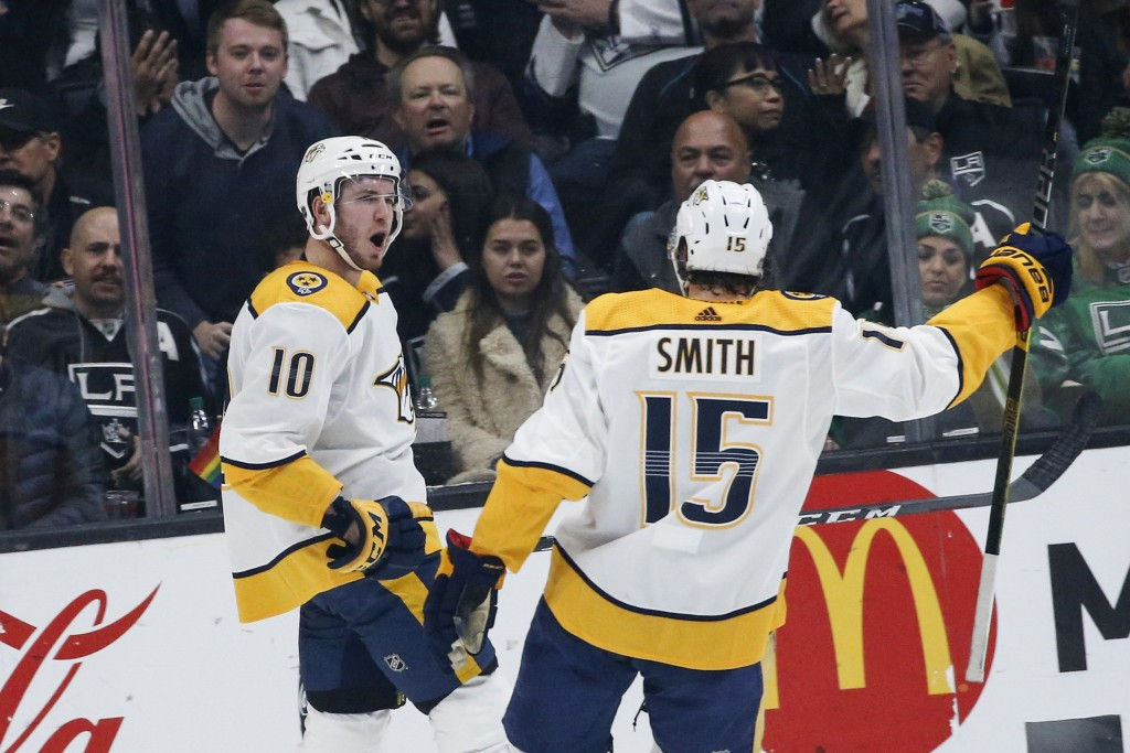 Nashville Predators forward Colton Sissons (10) celebrates his goal with Craig Smith (15) during the second period of an NHL hockey game against Los A