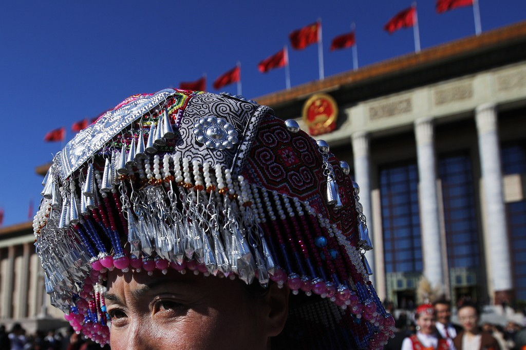 An ethnic minority delegate leaves the Great Hall of the People after attending the closing session of China's National People's Congress (NPC) in Bei