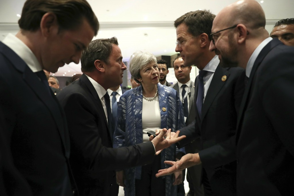 FILE - In this Sunday, Feb. 24, 2019 file photo British Prime Minister Theresa May, center, listens as Luxembourg's Prime Minister Xavier Bettel, seco