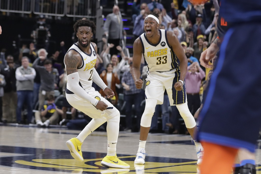 Indiana Pacers' Wesley Matthews (23) and Myles Turner (33) celebrate during the second half of an NBA basketball game against the Oklahoma City Thunde