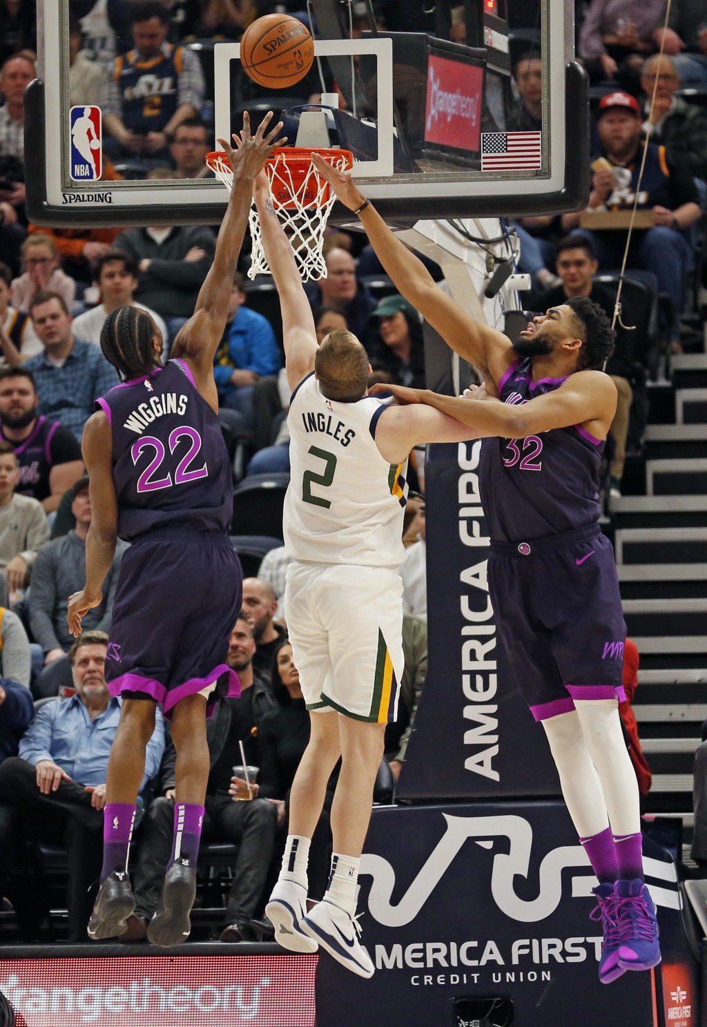 Minnesota Timberwolves' Andrew Wiggins (22) and Karl-Anthony Towns (32) defend against Utah Jazz forward Joe Ingles (2) in the first half during an NB