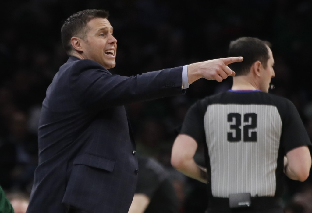 Sacramento Kings head coach David Joerger instructs his team in the first half of an NBA basketball game against the Boston Celtics, Thursday, March 1...