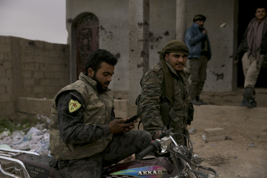 U.S.-backed Syrian Democratic Forces (SDF) wait outside Baghouz, Syria, to go to the front line where Islamic State militants are staging counter atta