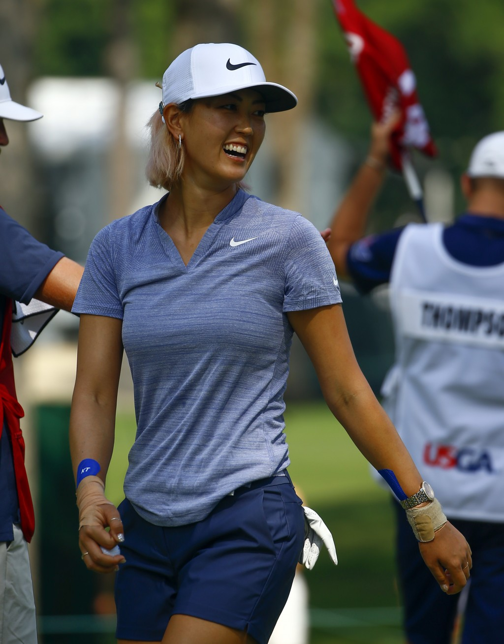 FILE - In this June 2, 2018, file photo, Michelle Wie smiles as she walks off the green after making a birdie putt on the 14th hole during the complet