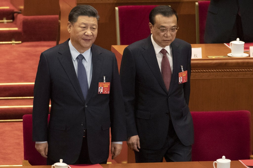 Chinese President Xi Jinping and Chinese Premier Li Keqiang arrive for the closing session of the National People's Congress in Beijing's Great hall o