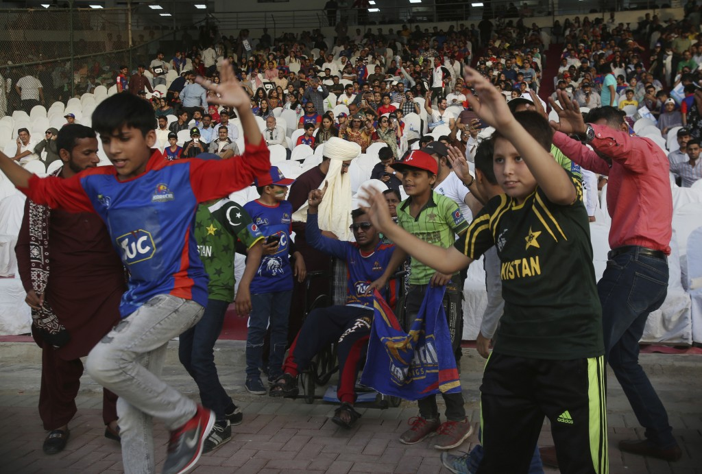 Pakistani cricket fans celebrate the victory of Islamabad United against Karachi Kings, in the Pakistan Super League playoff at National Stadium in Ka