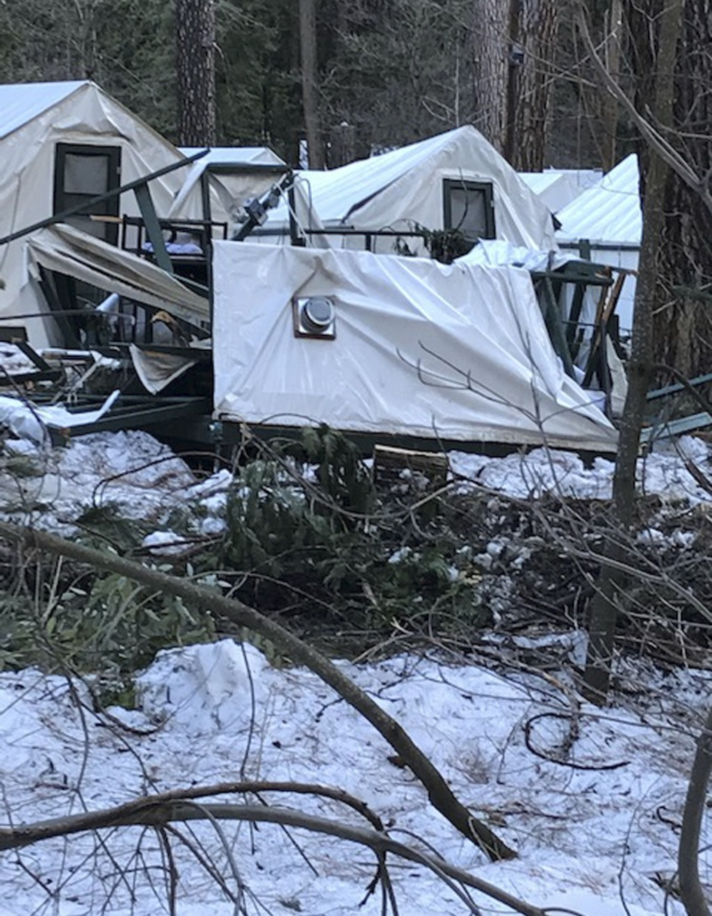 In this photo released Wednesday, March 13, 2019, by the National Park Service, is a damaged tent cabin after the recent heavy snowpack in Yosemite Na