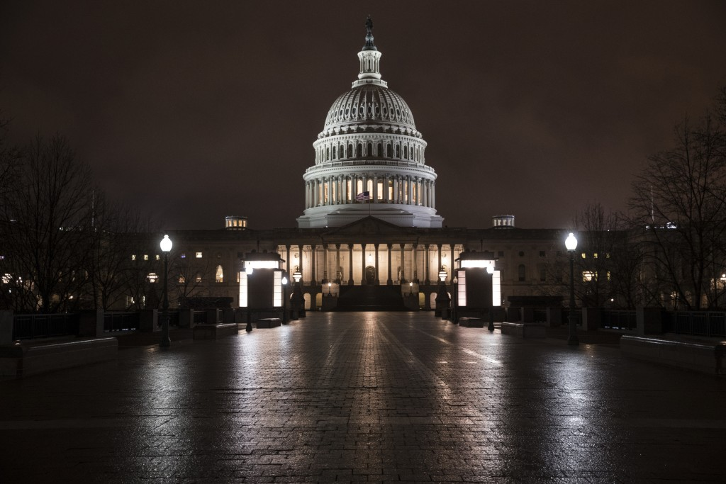 FILE - This March 21, 2018 file photo shows the Capitol in Washington before dawn. A Gallup poll in December 2018 asked respondents in the U.S. to ran