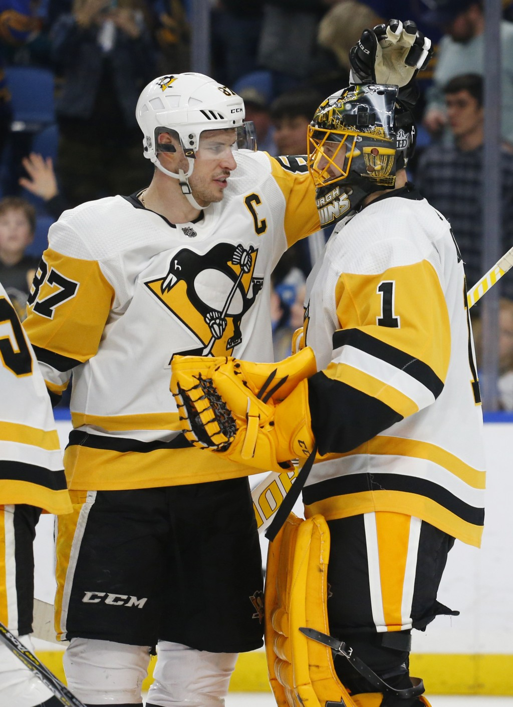 Pittsburgh Penguins Sidney Crosby (87) and Casey DeSmith (1) celebrate a 5-0 victory in the team's NHL hockey game against the Buffalo Sabres, Thursda