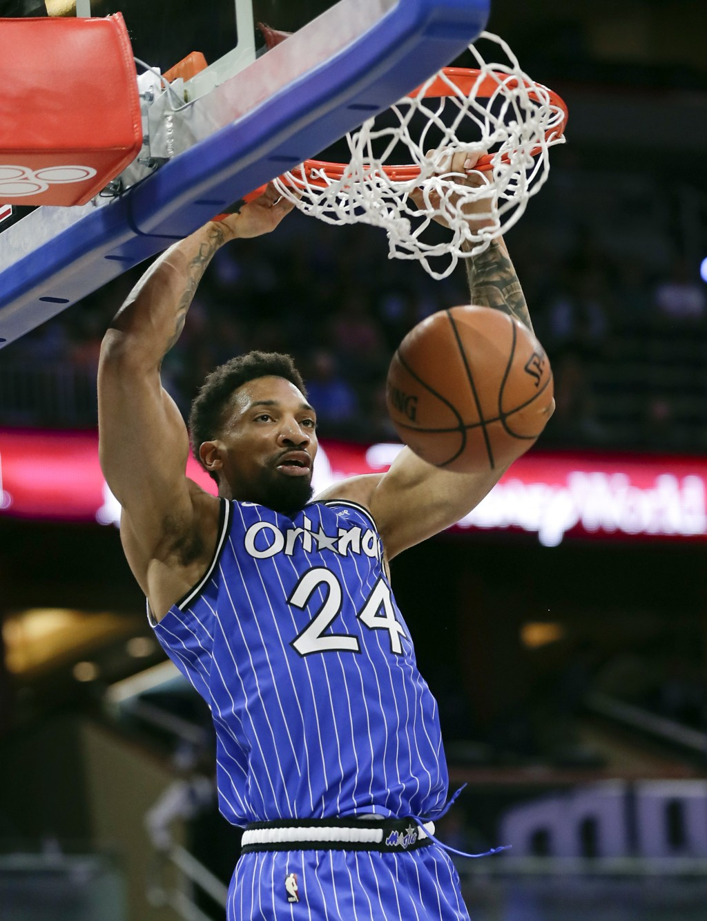 Orlando Magic's Khem Birch makes an uncontested dunk against the Cleveland Cavaliers during the first half of an NBA basketball game, Thursday, March