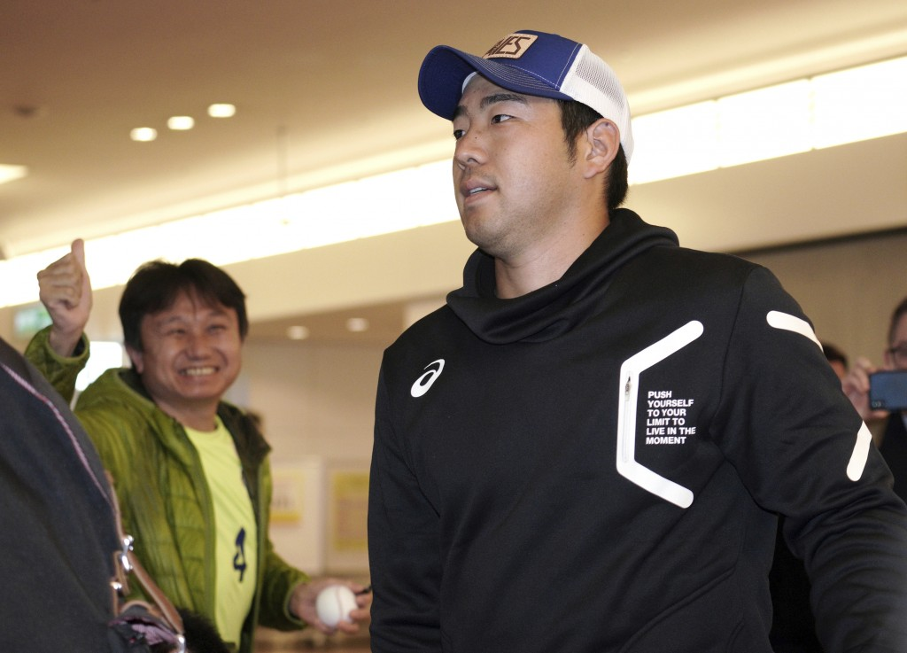 Seattle Mariners pitcher Yusei Kikuchi walks upon his team's arrival at Haneda international airport in Tokyo Friday, March 15, 2019. The Mariners wil